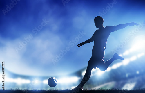 Tuinposter Sportwinkel Football, soccer match. A player shooting on goal