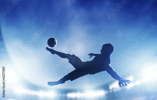 Football, soccer match. A player shooting on goal - 62177887