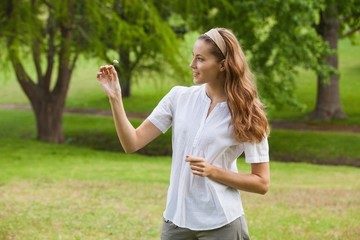 Woman holding a flower at park