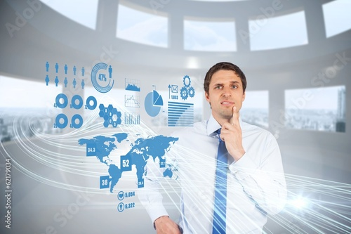 Confused businessman with global interface
