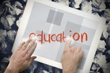 Hand touching education on search bar on tablet screen