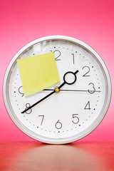 Clock with sticky paper