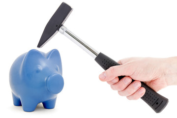 Piggy bank and hand with hammer