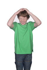 young boy scratching his head