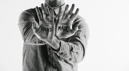 Man showing handmade word on his hands.