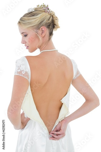 Rear view of beautiful bride wearing wedding dress