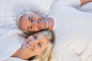 High angle portrait of a mature couple lying in bed