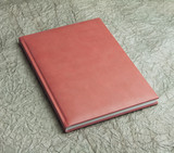 red  books in leather cover on a design paper, identity design,