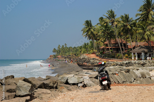 A view of Adayam beach with black sand and palms