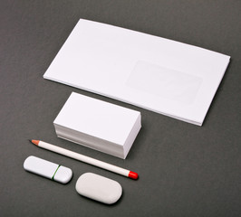 the white elements of corporate identity on a gray background