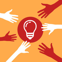hands reach for a light bulb