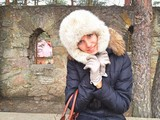 Woman wearing fur hat and wibter coat outdoor