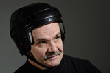 portrait of a man in hockey helmet