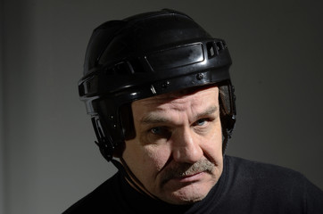 portrait of a senior in hockey helmet