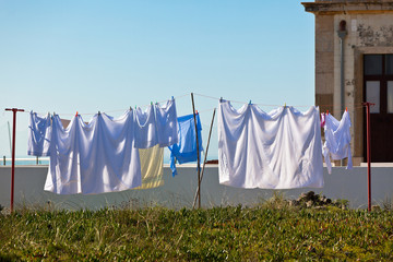 Washing hanging outside an old building, Portugal Coast