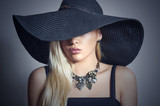 Beautiful Blond Woman in Black Hat.Accessories.Lady in Jewelry