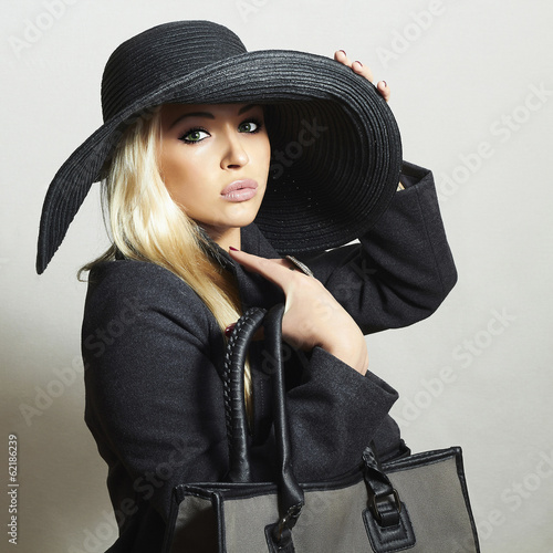 Beautiful Blond Woman in Hat.Beauty Girl with Handbag.Spring