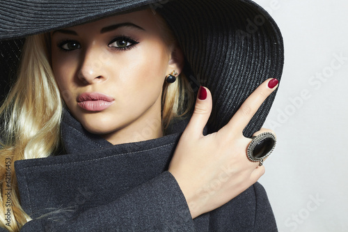 Beautiful Blond Woman in Black Hat.Fashionable Lady in Topcoat