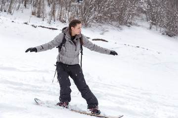 Freeriding of a female snowboarder.