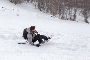 Female snowboarder playing with her snowboard