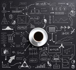 Cup of coffee over the black background with graphs