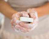 Closeup on young woman hands with soap