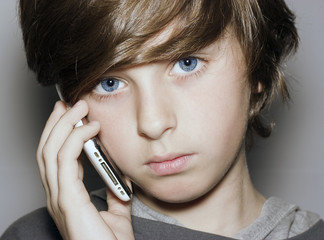 insightful look blue eyes boy face with telephone