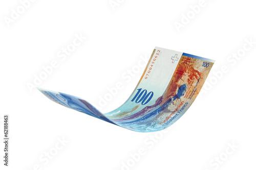 Leinwanddruck Bild Flying Swiss Franc note, isolated