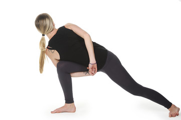 Beautiful young woman in great shape practicing yoga