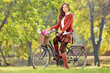 Beautiful female on her bicycle in a park