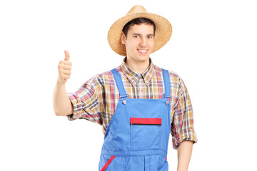 Young smiling farmer giving a thumb up