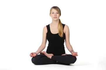 Beautiful young woman in great shape practicing yoga