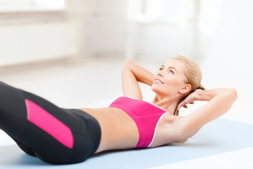 sporty woman doing exercise on the floor