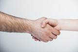 Man and woman shaking hands. Isolated on white background.