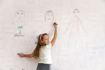 Girl draws on the wall