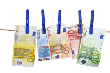 Euro banknotes hanging on laundry line attached with plastic clo
