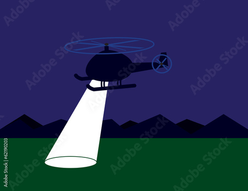 Helicopter searching at night with spotlight