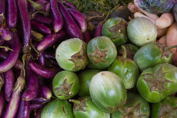 Green and purple aubergines at market in Myanmar