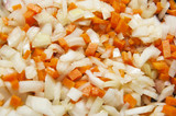 Closeup of chopped vegetables - carrot, onion, garlic