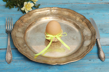 Table setting with cooked eggs, Easter time.