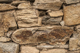 Dry masonry stone wall closeup as background