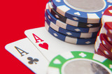 Two aces poker hand with poker chips stack