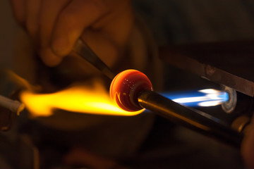 Glass blower work, Murano. Italy