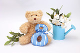 Composition on March 8 - teddy bear with flowers