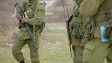 Three armed soldiers on duty. Close-up