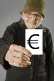 Elderly woman holding card with printed euro mark