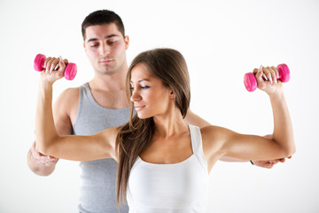 Personal trainer assisting a client