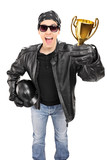 Male biker holding a trophy isolated on white background