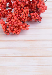 Artificial berries, on wooden background