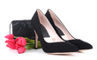 Beautiful black female shoes, bag and flowers, isolated on